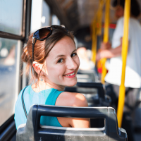 Female commuter on bus looking over shoulder