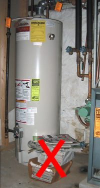 Waterheater with stack of papers next to it