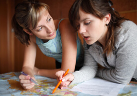 Two female students talking while looking at map